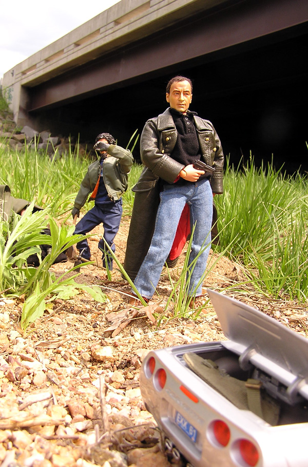Action figures depicting Mike Caffee and Pete under a bridge